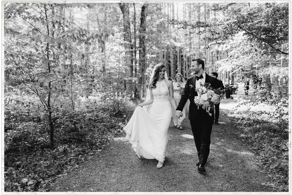 Bride and groom just married leaving their Catskills forest wedding ceremony