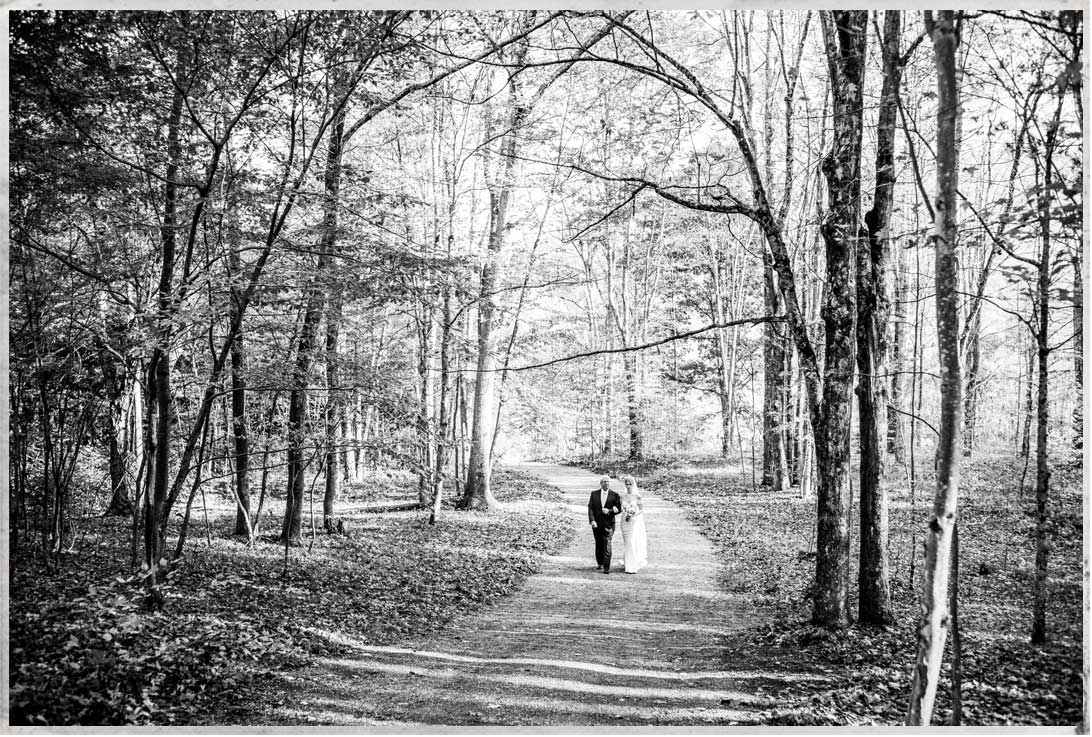 Father and daughter walking the aisle for a Catskills wedding at Roxbury Barn and Estate