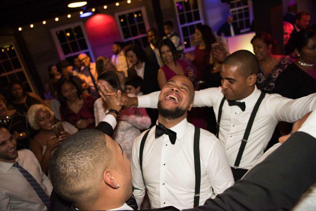 Happy groom on the dancefloor at Roxbury Barn and Estate