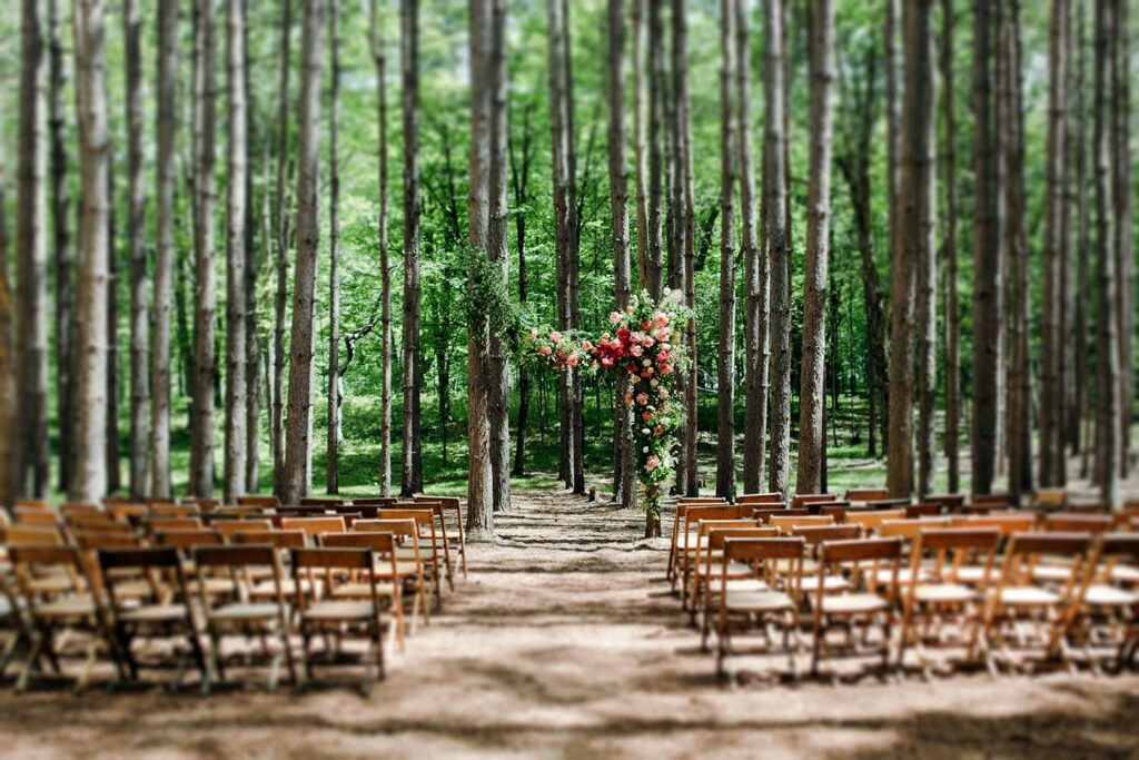 Flower arrangement for a wedding ceremony in the pine forest at Roxbury Barn and Estate