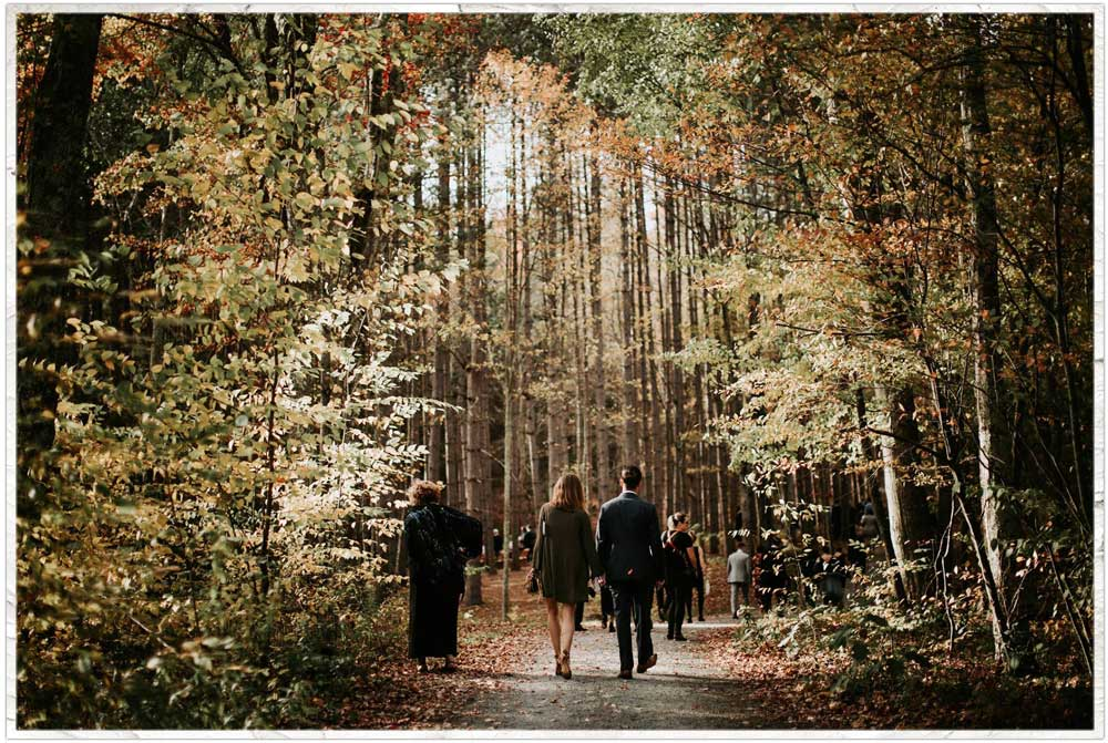 Walking into the forest for a wedding ceremony in the Catskill Mountains