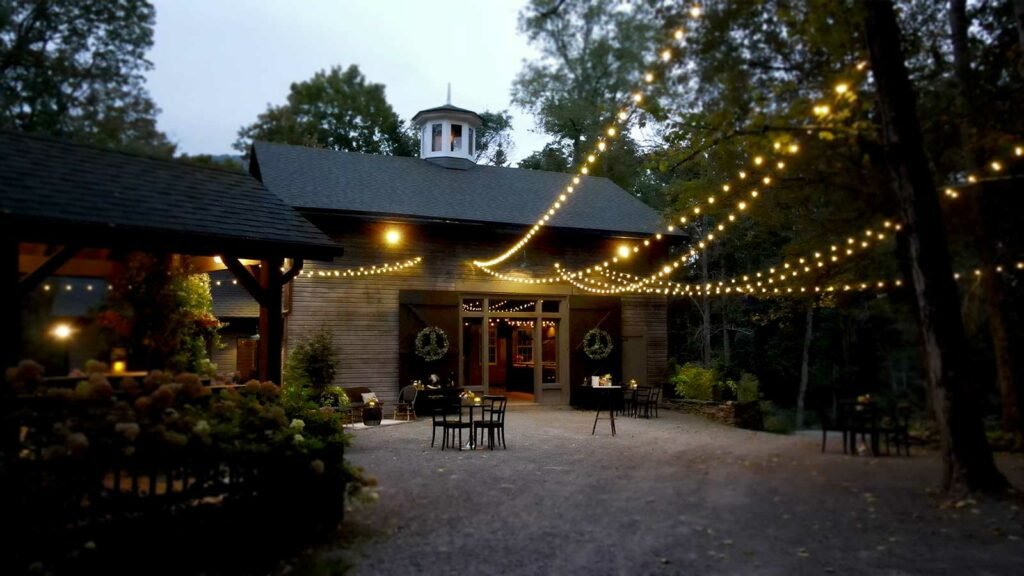 Courtyard in front of the carriage barn at dusk